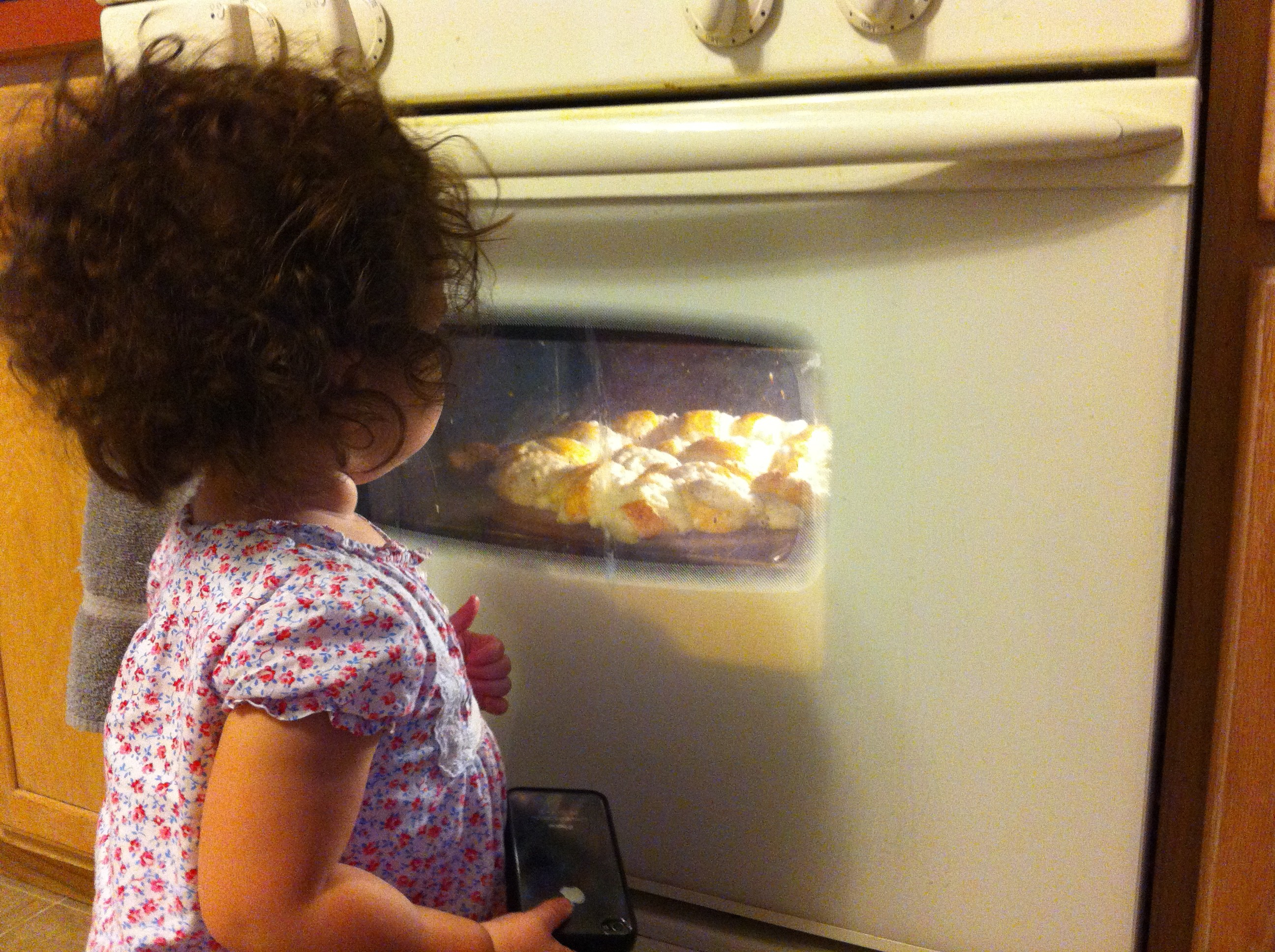 Baby girl loved watching the bread bake up